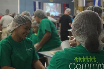 OneMain volunteers packing dry meals